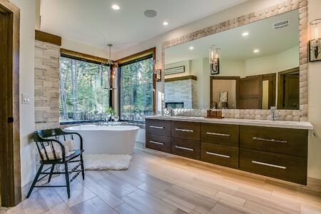 Master bathroom with huge corner windows throwing privacy to the wind