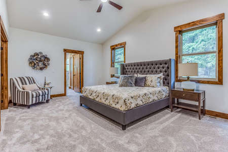 Spacious bedroom with newly installed carpet