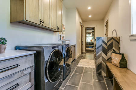 Mudroom, dog washing station, and laundry room all in one