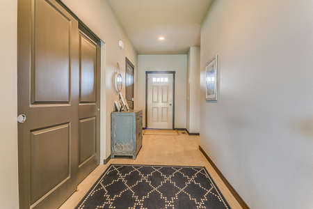 Front door and entry hallway in brand new home