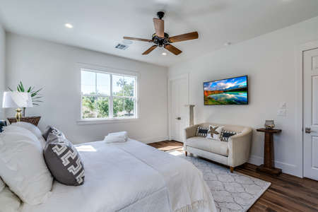 Lovely bedroom with hardwood floors and ceiling fan