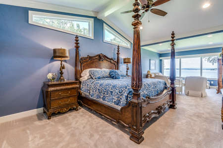 Awning windows and four poster bed in new lakeside home