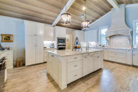 Open concept kitchen with square island and vaulted ceiling