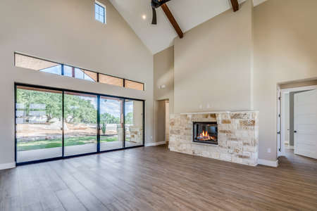 Empty great room of open layout floorplan home, newly constructed with precision and detail