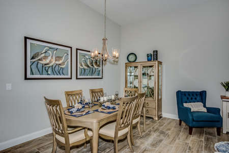 Beautiful dining area of new home with wall decors and hard flooring.