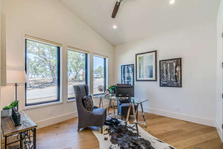 Perfect way to work remotely in luxury and comfort with glass top desk and hardwood flooring