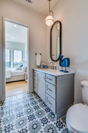 New bathroom with decorative flooring and connected to the bedroom