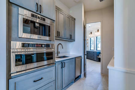 Butler pantry and double oven in newly constructed showcase home