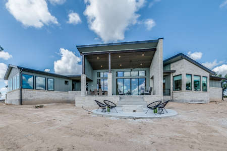 Unique new modern exterior of showcase home in Texas without grass landscaping finished yet