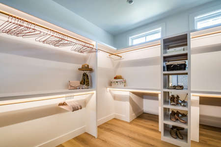 Luxury walk in closet with modern awning window and LED lighting