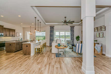 Open floor plan showing family room, dining area and kitchen.