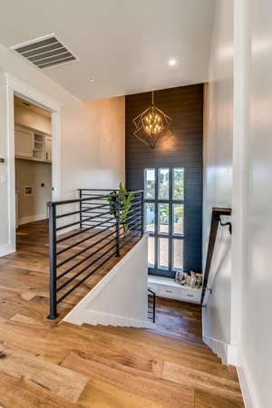 Modern metal railing on top floor looking down open stairway