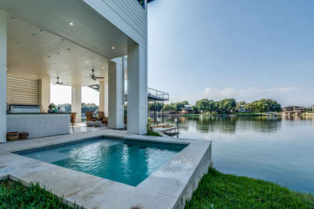 Texas home with outdoor pool area with lounging, dining and many other entertaining options