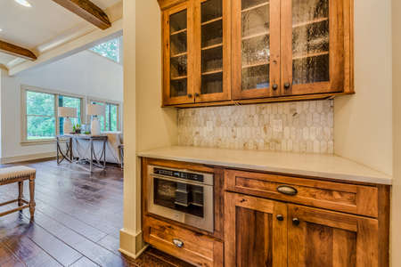 View of kitchen with island and cabinets.