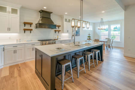 An island of the kitchen with the view of a living room.