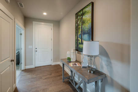 Front entryway in newly constructed open floor plan home.