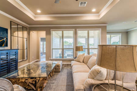 Expansive living room with lots of windows to enjoy the view.