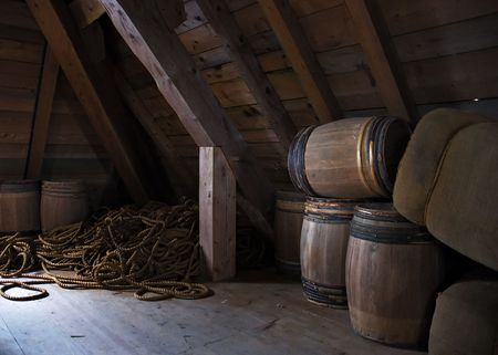 Louisbourg interior of a historic building, with storage barrels and rope Stock Photo