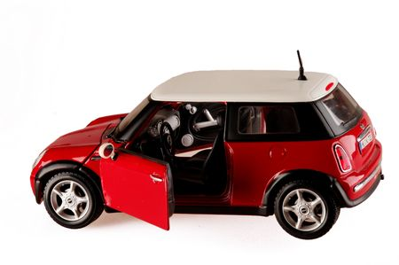 red toy model mini cooper isolated copy space open door