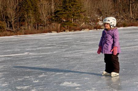 youg girl standing on ice lake