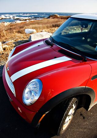 mini: Red Mini Cooper with rich blue ocean and sky Editorial