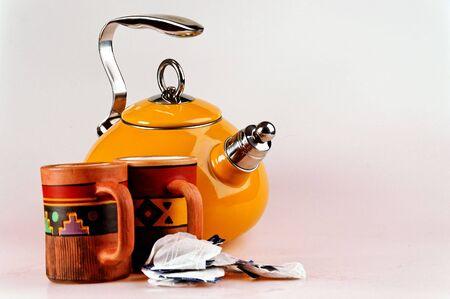 isolated tea pot with handmade mugs Stock Photo