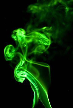 green smoke isolated on black Stock Photo