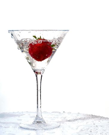 wet strawberry in martini glass