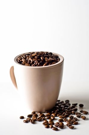whole bean coffee in mug isolated on white