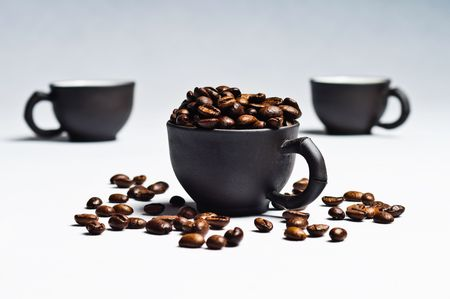 coffee beans and black cups