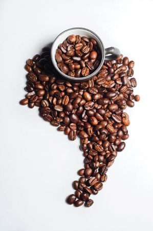 coffee beans shaped like south america and black cups