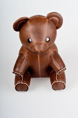 brown leather stitched teddy bear isolated on white