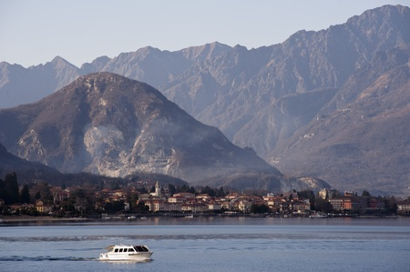 A boat passing by on Lake Maggiore, Italy Stock Photo - 12688688