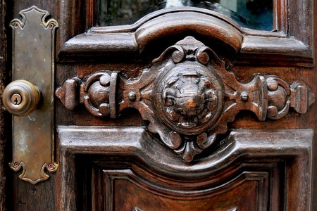 door knob: old dark brown wood brass doorknob
