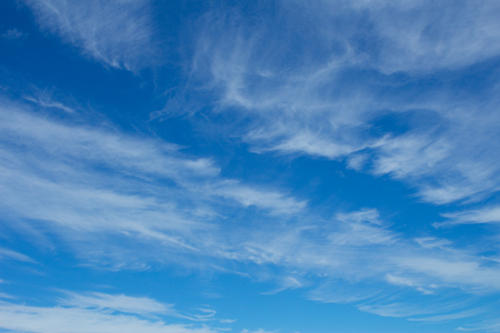 open windows: Fluffy white clouds on bright blue sky ideal for backgrounds Stock Photo