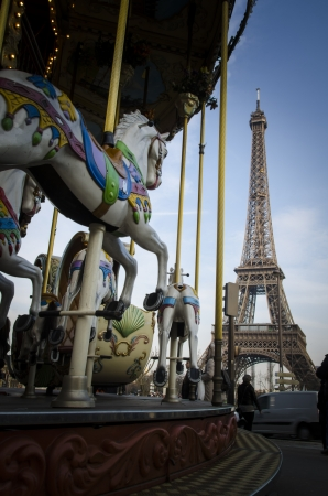 Low angle view of the Eiffel Tower in Paris with a prancing carousel horse in the foreground Stock Photo