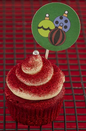 Chistmas cupcake with a twirl and decoration with baubles Stock Photo