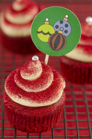 Red cupcake on a grate with christmas decoration