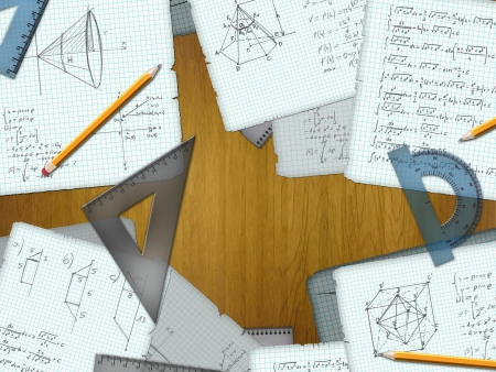school math calculations on a wooden desk photo