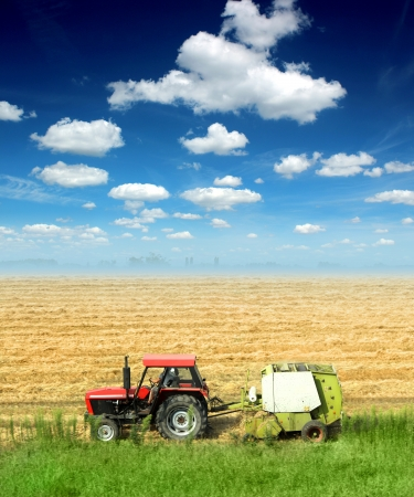 tractor in the field in a nice blue sky sunny day