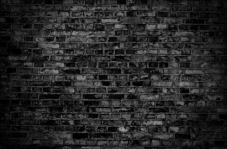Dark brick old wall texture or background  photo