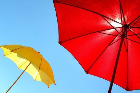 sunshades: colorful sunshades umbrellas on a sunny summer day