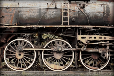 rusted: old damaged rusted steam train Stock Photo