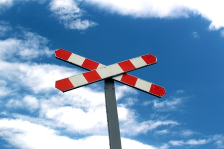 old railway sign in the beautiful blue sky photo