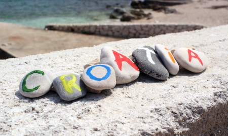 Croatia colorful inscription painted on the stones - vacation photo Stock Photo