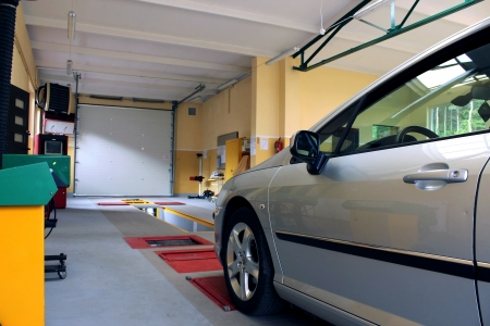 auto inspection station with modern silver car Archivio Fotografico