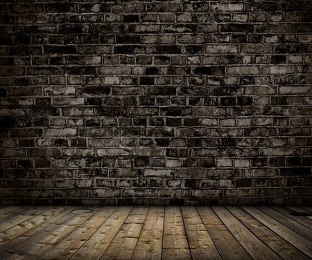 piso piedra: interior con pared de ladrillo gris y fondo de madera piso Foto de archivo