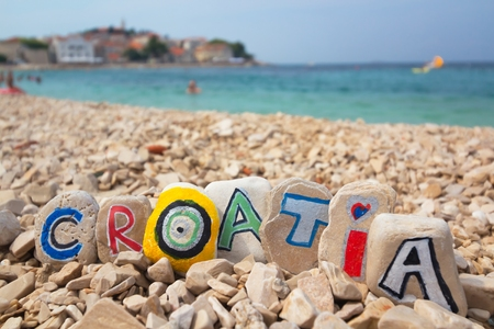 croatia: Croatia paint on stones on the beach adriatic sea background Stock Photo