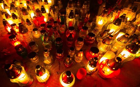 all saints day: Candle flames illuminating a Polish cemetery during All Saints Day Stock Photo