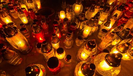 saints: Candles on the graves. All Saints Day, Poland
